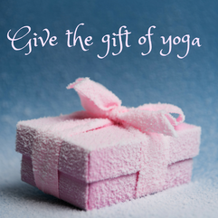 give the gift of yoga image with wrapped present